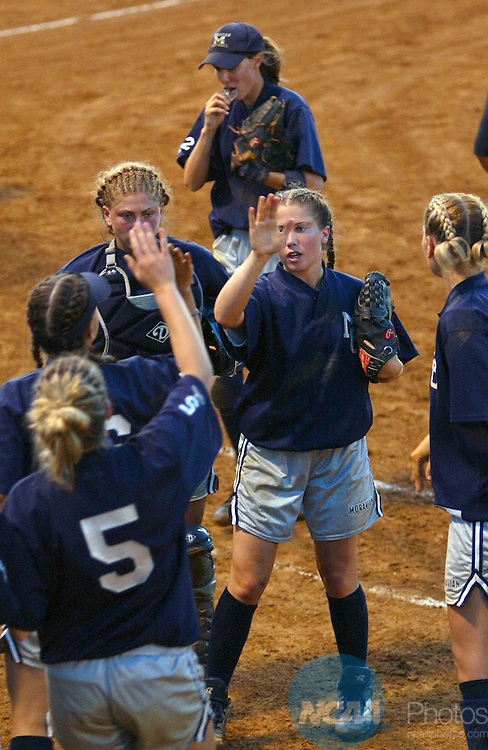 17 MAY 2004:  Moravian College teammates congratulate pitcher Meagan Hennessy (2) on a strong inning against the University of St. Thomas  during the Division III Women's Softball Championship held at the James A. Moyer Sports Complex in Salem, VA.  St. Thomas defeated Moravian 2-0 for the national title.  Jeff Greenough/NCAA Photos