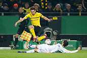 February 5th 2019, Dortmund, Germany, German DFB Cup round of 16, Borussia Dortmund versus SV Werder Bremen;  Dortmund's Raphael Guerreiro (top) and Nuri Sahin from Bremen challenge for the ball.