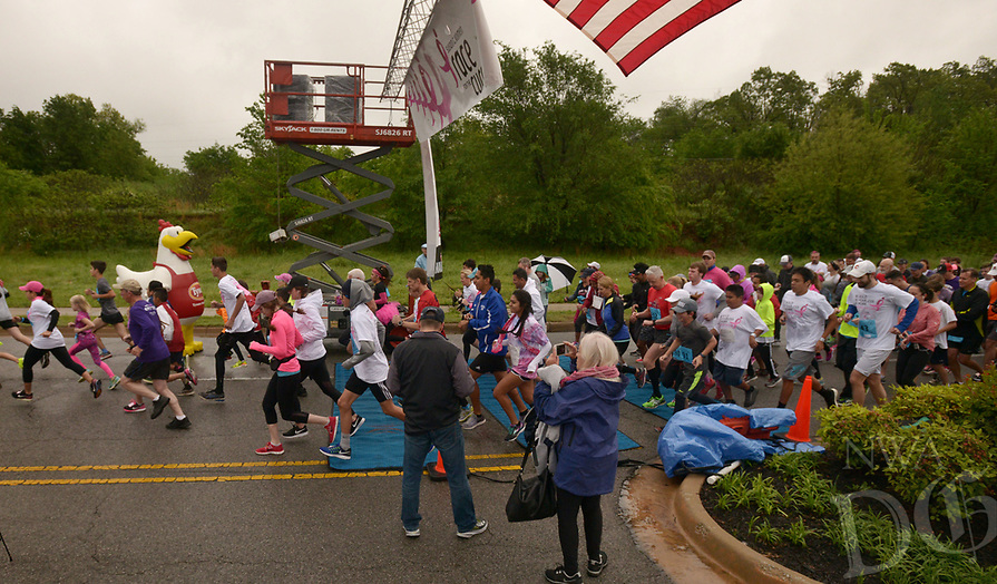 NWA Democrat-Gazette/BEN GOFF @NWABENGOFF<br /> Runners start the competetive 5K run Saturday, April 22, 2017, during the annual Susan G. Komen Ozark Race for the Cure at Pinnacle Hills Promenade in Rogers.
