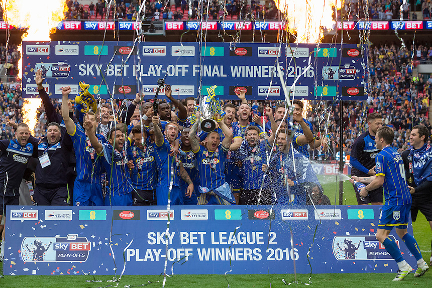 AFC Wimbledon players celebrate by lifting the League 2 play off final trophy<br /> <br /> Photographer Craig Mercer/CameraSport<br /> <br /> Football - The Football League Sky Bet League Two Play-Off Final - AFC Wimbledon v Plymouth Argyle - Monday 30 May 2016 - Wembley Stadium - London<br /> <br /> World Copyright &copy; 2016 CameraSport. All rights reserved. 43 Linden Ave. Countesthorpe. Leicester. England. LE8 5PG - Tel: +44 (0) 116 277 4147 - admin@camerasport.com - www.camerasport.com