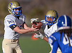Reed's Matt Denn hands off to Jaden Carter during the NIAA D-1 Northern Regional title game against Carson at Bishop Manogue High School in Reno, Nev., on Saturday, Nov. 29, 2014. Reed won 28-25.<br /> Photo by Cathleen Allison