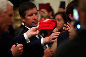 A MAGA hat, signed by United States President Donald J. Trump for a guest at the Hispanic Heritage Month Reception at the White House in Washington, DC on September 27, 2019. <br /> Credit: Yuri Gripas / Pool via CNP