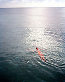 HONDURAS, Roatan, young woman floating in the Caribbean Sea