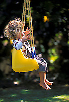 "Young girl swinging with """" no hands"