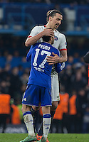 Zlatan Ibrahimovic of Paris Saint-Germain consoles Pedro of Chelsea on the final whistle during the UEFA Champions League Round of 16 2nd leg match between Chelsea and PSG at Stamford Bridge, London, England on 9 March 2016. Photo by Andy Rowland.