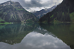 Mountains reflected in Lake Visalpsee, Reutte district. Austria.