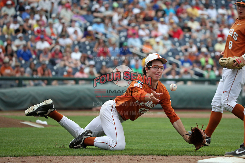 John Curtiss #43 of the Texas Longhorns fields during Game 1 of the 2014 Men's College World Series between the UC Irvine Anteaters and Texas Longhorns at TD Ameritrade Park on June 14, 2014 in Omaha, Nebraska. (Brace Hemmelgarn/Four Seam Images)