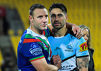 Blake Green (Warriors) commiserates with Shaun Johnson (Sharks) after the National Rugby League match between the NZ Warriors and Cronulla Sharks at Westpac Stadium in Wellington, New Zealand on Friday, 19 July 2019. Photo: Dave Lintott / lintottphoto.co.nz
