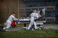 A victim of the Covid-19 virus is evacuated from the Mulhouse civil hospital, eastern France, March 23, 2020. (AP Photo/Jean-Francois Badias)