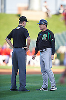 Dayton Dragons manager Dick Schofield (22) questions a call with umpire Vince Jackson during a game against the Peoria Chiefs on May 6, 2016 at Dozer Park in Peoria, Illinois.  Peoria defeated Dayton 5-0.  (Mike Janes/Four Seam Images)