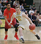 SPEARFISH, SD: DECEMBER 30:  Wyatt Krogman #11 of Black Hills State drives past Will Newman #1 of CSU Pueblo during their game Saturday evening at the Donald E. Young Center in Spearfish, S.D.   (Photo by Dick Carlson/Inertia