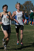 Notre Dame junior Rudy McClellan (892) battles a Helias Catholic runner with less than a half-mile to go in the Class 3 race at the 2015 MSHSAA State Cross Country Championships. McClellan, appears not to have been able to finish and doesn't appear in the results.