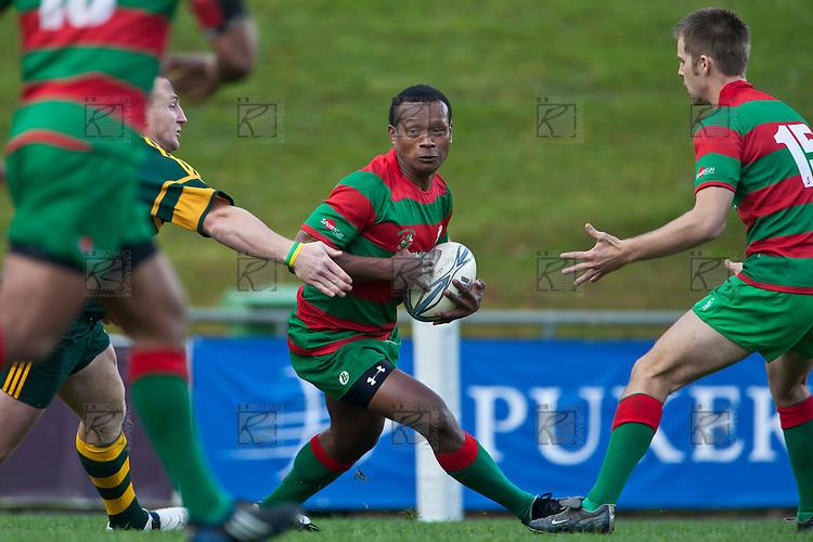 Willie Heperi tries to avoid Nigel Watsons tackle.Counties Manukau McNamara Cup Premier Club Rugby final between Pukekohe andWaiuku, held at Bayer Growers Stadium, on Saturday July 17th. Waiuku won 25 - 20.