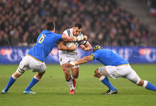 23rd February 2018, Orange Stade Velodrome,Marseille, France; 6-Nations International rugby, France versus Italy;  Lionel Beauxis (fra) stopped by Sebastian Negri Da Oleggio  and Maxime Mbanda
