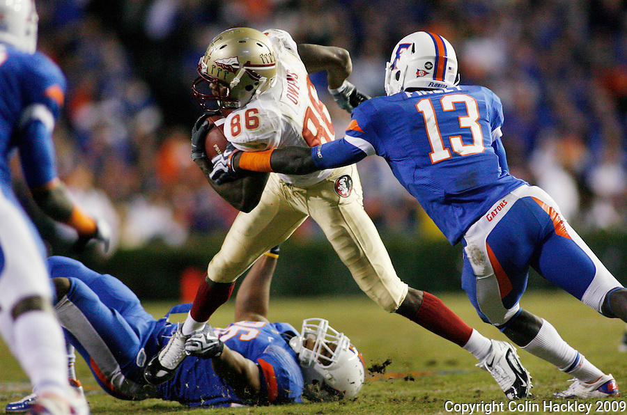 GAINESVILLE, FL 11/28/09-FSU-UF FB09 CH51-Florida State's Rod Owens tries to elude Florida's A.J. Alexander, on ground, and Dee Finley during second half action Saturday at Florida Field in Gainesville. The Gators beat the Seminoles 37-10..COLIN HACKLEY PHOTO