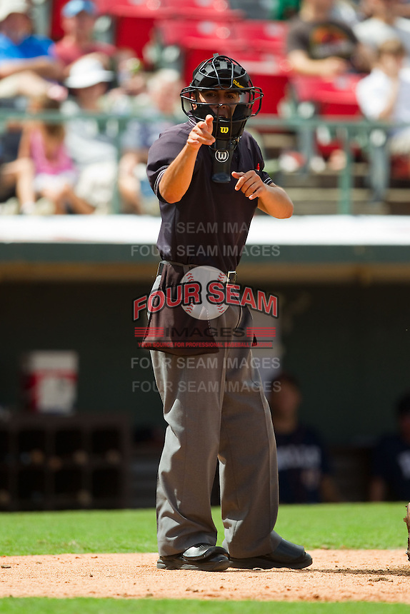 Home plate umpire Gabe Morales makes a strike call during the International League game between the Durham Bulls and the Charlotte Knights at Knights Stadium on August 18, 2013 in Fort Mill, South Carolina.  The Bulls defeated the Knights 8-5 in Game One of a double-header.  (Brian Westerholt/Four Seam Images)