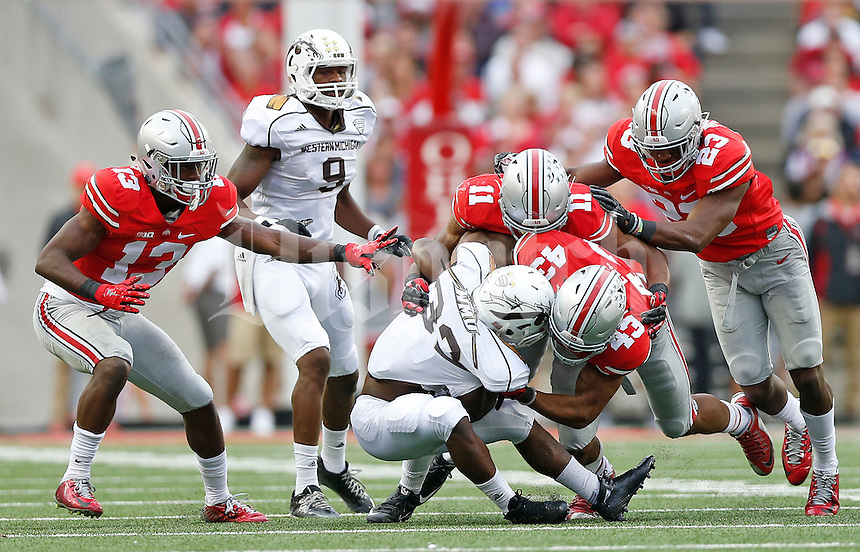 Ohio State Buckeyes linebacker Darron Lee (43) and Ohio State Buckeyes safety Vonn Bell (11) take down Western Michigan Broncos running back Jamauri Bogan (32) in the third quarter of the college football game between the Ohio State Buckeyes and the Western Michigan Broncos at Ohio Stadium in Columbus, Saturday afternoon, September 26, 2015. The Ohio State Buckeyes defeated the Western Michigan Broncos 38 - 12. (The Columbus Dispatch / Eamon Queeney)
