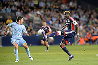 Saer Sene (39) New England forward controls the ball in front of Sporting KC defender Matt Besler... Sporting Kansas City defeated New England Revolution 3-0 at LIVESTRONG Sporting Park, Kansas City, Kansas.