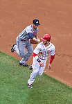 4 April 2014: Atlanta Braves shortstop Andrelton Simmons get Washington Nationals outfielder Bryce Harper caught in a rundown in the second inning of the Nationals Home Opening Game at Nationals Park in Washington, DC. The Braves edged out the Nationals 2-1 in their first meeting of the 2014 MLB season. Mandatory Credit: Ed Wolfstein Photo *** RAW (NEF) Image File Available ***