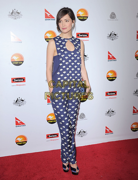 Rose Byrne.at The G'Day USA Black Tie Gala held at The JW Marriot at LA Live in Los Angeles, California, January 12th 2013.                                                                 .full length top trousers blue  cut out navy white beaded beads hair up fringe print clutch bag peep toe shoes sleeveless silk satin hand in pocket .CAP/DVS.©Debbie VanStory/Capital Pictures.