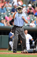 Home plate umpire Matt McCoy makes a call during a game between the Mississippi Braves and Montgomery Biscuits on April 22, 2014 at Riverwalk Stadium in Montgomery, Alabama.  Mississippi defeated Montgomery 6-2.  (Mike Janes/Four Seam Images)