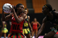 23.02.2018 Malawi's Bridget Kumwenda in action during the Malawi v Jamaica Taini Jamison Trophy netball match at the North Shore Events Centre in Auckland. Mandatory Photo Credit ©Michael Bradley.