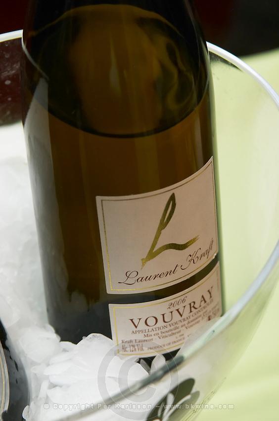 Bottles in ice bucket. Laurent Kraft, Vouvray 2006. Touraine, Loire France
