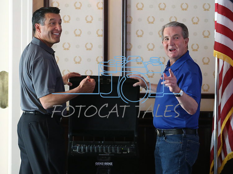 Gov. Brian Sandoval and Carson City Mayor Bob Crowell offer audio equipment help at the Epic Rides Carson City Off-Road kick off ceremony at the Governor's Mansion in Carson City, Nev., on Friday, June 17, 2016.<br />
