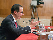 United States Secretary of the Treasury Steven Mnuchin testifies before the US Senate Committee on Appropriations during the hearing to review the fiscal year 2018 budget request for the US Department of the Treasury on Capitol Hill in Washington, DC on Wednesday, July 26, 2017.<br /> Credit: Ron Sachs / CNP