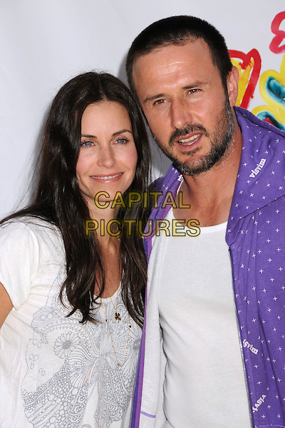 "COURTENEY COX ARQUETTE & DAVID ARQUETTE .""A Time For Heroes"" Celebrity Carnival Benefit for the Elizabeth Glaser Pediatric AIDS Foundation at the Wadsworth Fairgrounds, Los Angeles, California, USA..June 8th, 2008.half length courtney purple jacket white top married husband wife beard facial hair .CAP/ADM/BP.©Byron Purvis/AdMedia/Capital Pictures."