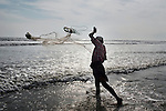 Abul Kalam, a Rohingya from Myanmar, who living in a camp for Rohingya people in Ukhia, throws fishing net into the sea near the camp.