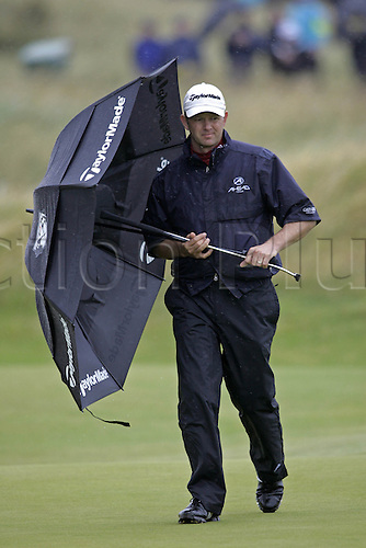 17 July 2008: South African golfer Retief Goosen (RSA) shelters from the raid during the first round of the Open Championship at Royal Birkdale Photo: Neil Tingle/Action Plus..080717 golf wet weather