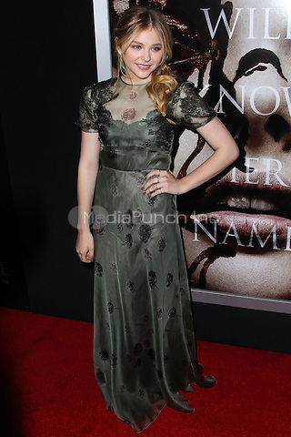 """HOLLYWOOD, CA - OCTOBER 07: Chloe Grace Moretz arrives at the """"Carrie"""" Los Angeles Premiere held at ArcLight Hollywood on October 7, 2013 in Hollywood, California. Credit: Collin/RTN/MediaPunch Inc."""