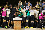 "Steven Echevarria (15) of the Wake Forest Demon Deacons celebrates with his teammates and the fans on ""Walt Chyzowych Alumni Hill"" following his game winning goal in the second overtime period against the Clemson Tigers at Spry Soccer Stadium on September 29, 2017 in Winston-Salem, North Carolina.  The Demon Deacons defeated the Tigers 3-2 in 2OT.  (Brian Westerholt/Sports On Film)"