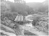 River-side view of the washed-out Silver Creek Bridge 66-C (?).<br /> RGS  Rico, CO