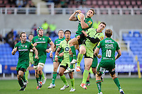 Andrew Fenby of London Irish outjumps George North of Northampton Saints as Ken Pisi of Northampton Saints looks on in surprise during the Premiership Rugby match between London Irish and Northampton Saints at the Madejski Stadium on Saturday 4th October 2014 (Photo by Rob Munro)