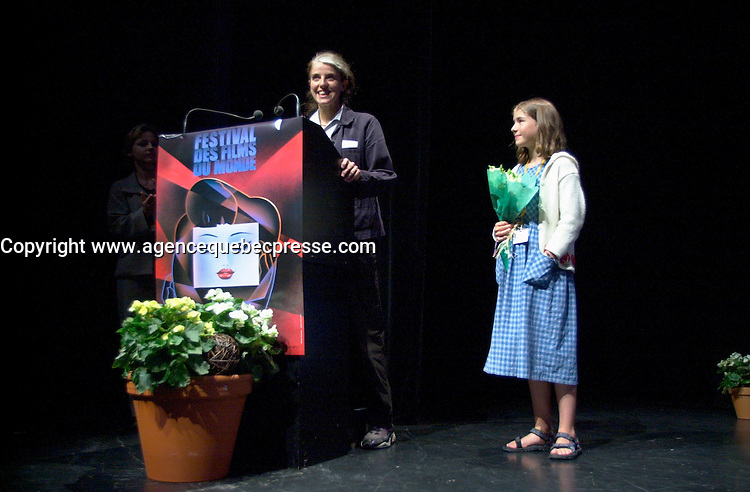 August 29,  2002, Montreal, Quebec, Canada<br /> <br /> Anne Wild, Film Maker (L)<br /> Henriette Confurius, 11year old actress (R)<br /> on stage at the Maisonneuve Theater of the PLACE DES ARTS in Montreal Canada<br /> , before the screening of Wild's movie<br /> MEIN ERSTES WUNDER (My First Miracle), presented in the official competitionof the 26th World Film Festival, August 29, 2002<br /> <br /> Born in Offenburg, Germany in 1967, Anne Wild studied literature, philosophy and art history at the University of Freiburg and acting at the Academy of Music and Applied Arts in Stuttgart. In the mid-1990s she worked in advertising in Hamburg and Berlin, then studied screenwriting and directing. Since 1997 she has worked as a freelance journalist for newspapers, radio and television. She wrote the script for WAS TUN, WENN'S BRENNT? (2002) and directed Afternoon in Siedlisko (2000) and Ballett ist ausgefallen (2001). MY FIRST MIRACLE marks her directorial debut in features. <br /> , LUCIE AUBRAC (Claude Berri, 1997), THE COMEDIAN HARMONISTS (Joseph Vilsmaier, 1997), and two by Tom Tykwer, WINTERSLEEPERS (1997) and RUN, LOLA, RUN (1998). He starred in Roland Suso Richter's hit film THE TUNNEL (2001), winner of the audience award at last year's Montreal World Film Festival, and his most recent film, THE SEAGULL'S LAUGHTER, is also showing at this year's Festival. He represents the new wave of german actors. <br /> <br /> <br /> Mandatory Credit: Photo by Pierre Roussel- Images Distribution. (&copy;) Copyright 2002 by Pierre Roussel <br /> <br /> NOTE : <br />  Nikon D-1 jpeg opened with Qimage icc profile, saved in Adobe 1998 RGB<br /> .Uncompressed  Uncropped  Original  size  file availble on request.