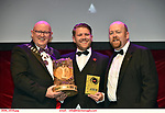 16-6-2019:  Alan Greaney- Gomez Addams- The Addams Family-Ennis Musical Society winner of the Best Actor award at the annual AIMS (Association of Irish Musical Societies) in the INEC Killarney at the weekend receiving the trophy from Seamus Power, President, AIMS left and Rob Donnelly, Vice-President.<br /> Photo: Don MacMonagle - macmonagle.com<br /> <br /> repro free photo from AIMS<br /> <br /> AIMS PRESS RELEASE: There was plenty of glitz and glamour in Killarney on Saturday night as The Association of Irish Musical Societies has its Annual Awards Ceremony in Killarney. Over 1,500 people could be heard over the Kerry mountains as the winners were announced by MC Fergal D'Arcy. Many societies were double winners on the night including UCD Musical Society, Dublin were dancing all the way to the trophies winning Best Choreography and Best Choreographer for Leah Meagher for Cabaret and  Tullamore Musical Society who took their moment as Chris Corroon won Best Male Singer for his sinful performance as Henry Jekyll in Jekyll &Hyde and also Director Paul Norton who'd plenty to celebrate picking Best Director for  the same show. The moment was once again taken by Jekyll&Hyde by Dùn Laoighaire Musical&Dramatic Society as Kevin Hartnett took up Best Male Singer in the Sullivan category.Nenagh Youth Musical Society raised their voices high and took home Best Ensemble. It was a superior night for Enniscorthy Musical Society by winning Best Comedienne for Jennifer Byrne as Mother Superior and Best Technical too. Portlaoise Musical Society rose to the top by taking home Best Overall Show in the Gilbert section for their stunning production of Titanic. Oyster Lane Theatre Group, Wexford flew their flag high taking home Best Overall Show in the Sullivan Section for their breathtaking production of Michael Collins-a Musical Drama.<br /> Other winners on the night included Best Comedian for Ronan Walsh as Officer Lockstock in Urinetown for Trim Musical Society, Best Actress in a Supporting Role for  Roisin Law