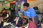 A LyondellBasell volunteer helps Energized for STEM students work through allocations of provided funds among the many family expenses.
