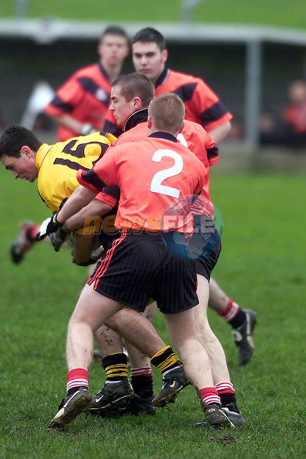 "dundalk schools no 2 Nicholas Smyth and no 10 Nigel Shevlin try to stop St patricks Classical school no 15 Colm Tolan during the leinster colleges senior Football ""A"" final in droghea..Picture Fran Caffrey Newsfile."