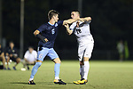 CARY, NC - OCTOBER 06: UNC's Cam Lindley pushes Wake Forest's Brad Dunwell (12). The University of North Carolina Tar Heels hosted the Wake Forest University Demon Deacons on October 6, 2017 at Koka Booth Field at WakeMed Soccer Park in Cary, NC in a Division I college soccer game.