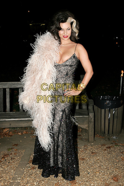 "IMMODESTY BLAIZE.The ""End of Summer Ball"" at Berkeley Square, London, England. .September 25th 2008.full length black long dress maxi lace print beige feather wrap boa hand on hip skunk dyed hair streak cleavage .CAP/AH.©Adam Houghton/Capital Pictures."