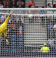 Men's Olympic Football match Honduras v Morocco on 26.7.12...Jose Mendoza of Honduras beaten by the lob of Zakaria Labyad of Morocco, during the Honduras v Morocco Men's Olympic Football match at Hampden Park, Glasgow..........