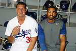 LOS ANGELES, CA. - September 02: Blake Griffin, top draft pick of the Los Angeles Clippers and Matt Kemp of the Los Angeles Dodgers  posing in the Dodger dugout before the ceremonial first pitch at Dodger Stadium in Los Angeles, California on September 2, 2009.