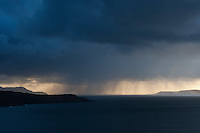Rain showers fall over Loch Brittle, Glenbrittle, Isle of Skye, Scotland