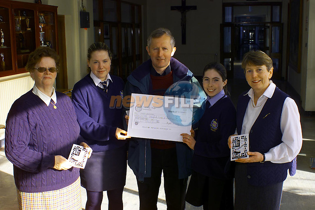 Sr Colette McCloskey, Shiela Coyle 5th Year, Emer Brady 1st year and Ann Mulligan Vice-Principle Our Ladys College Greenhills present a cheque to Fr Flor O'Callaghan O.S.A. for Drogheda Cares at Christmas..Pic Fran Caffrey Newsfile..Camera:   DCS620C.Serial #: K620C-01974.Width:    1728.Height:   1152.Date:  10/2/00.Time:   12:52:49.DCS6XX Image.FW Ver:   3.0.9.TIFF Image.Look:   Product.Antialiasing Filter:  Removed.Tagged.Counter:    [1546].Shutter:  1/50.Aperture:  f8.0.ISO Speed:  200.Max Aperture:  f1.8.Min Aperture:  f21.Focal Length:  28.Exposure Mode:  Manual (M).Meter Mode:  Color Matrix.Drive Mode:  Continuous High (CH).Focus Mode:  Single (AF-S).Focus Point:  Center.Flash Mode:  Normal Sync.Compensation:  +0.0.Flash Compensation:  +0.0.Self Timer Time:  5s.White balance: Custom.Time: 12:52:49.043.