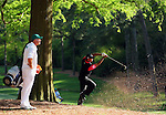 AUGUSTA, GA- APRIL 13:  Tiger Woods hits his 2nd shot out of the rough in trees as Caddie Steve Williams watches on the 13th fairway during a the final round of the 2008 Masters on April 13, 2008 at Augusta National Golf Club in Augusta, Georgia. (Photo by Donald Miralle)