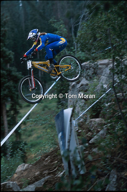 Marla Streb airs a big drop near the bottom of the Downhill course at Durango Mountain Resort in Colorado.  August 2002. Photo &copy; Tom Moran<br />