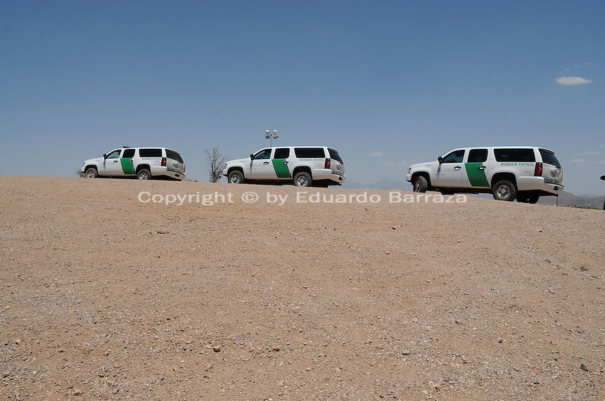 Nogales, Arizona - Three Border Patrol vehicles parked near the international U.S.-Mexico border. The vehicles were part of a caravan that took journalists to the border in an event sponsored by the U.S. Customs and Border Protection agency. This area is near the Border Patrol Nogales station, one of eight in the Tucson Sector, which is the busiest on the U.S.-Mexico border for illegal immigration, drug smuggling and border deaths. Photo by Eduardo © 2012