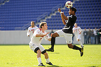 Marc Cintron (9) of the Providence Friars heads the ball as Charlie Campbell (2)  of the Louisville Cardinals looks on during the finals of the Big East Men's Soccer Championship at Red Bull Arena in Harrison, NJ, on November 14, 2010.